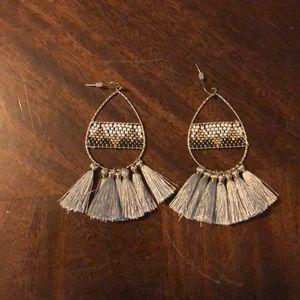 Gray tassel earring.